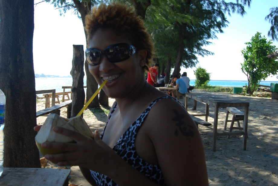 Me sipping on some sweet coconut water.