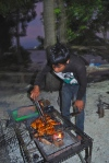 Grilling up some ayam bakar- grilled chicken at sunset. Pulau Tidung, Indonesia.  Photo by: Diana O'Gilvie