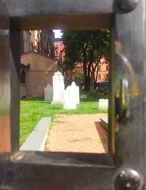 Shot through a tiny opening in a big door. Photo by Diana O'Gilvie